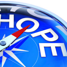 compass with magnet pointing to word hope