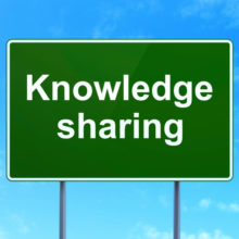 road sign knowledge sharing blue sky background