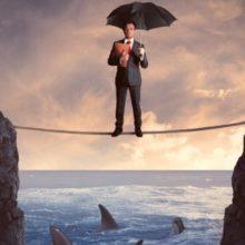 man on tightrope with umbrella