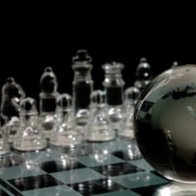 black and white chessboard with globe on top