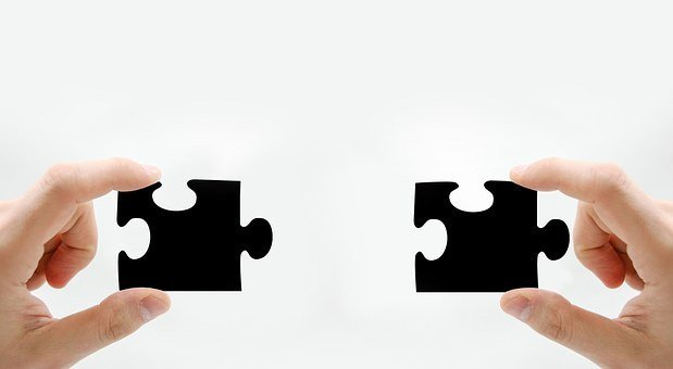 two puzzle pieces that will fit together