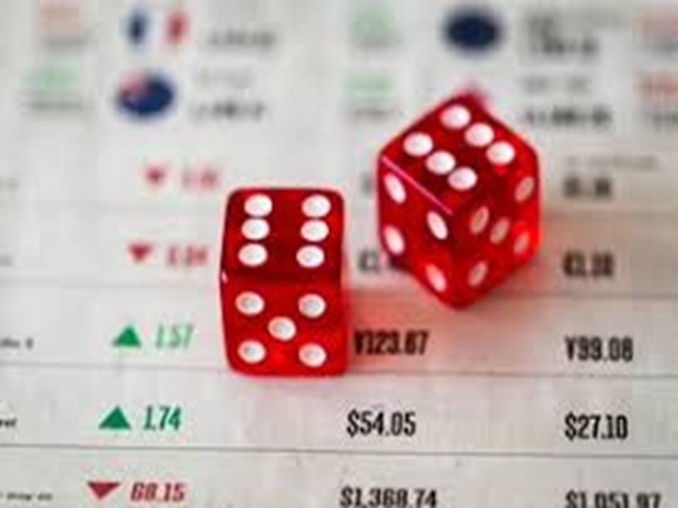 red dice on financial balance sheet